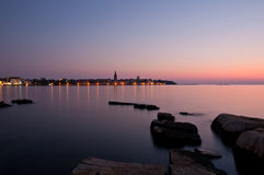 Beautiful sunset with the Porec town skyline Royalty Free Stock Photography