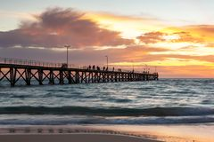 A beautiful sunset at Port Noarlunga with the jetty and motion blur on the water at Port Noarlunga South Australia on 18th March royalty free stock photography