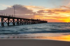 A beautiful sunset at Port Noarlunga with the jetty and motion blur on the water at Port Noarlunga South Australia on 18th March stock photography