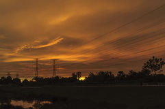 Beautiful sunset. A beautiful sunset with power line silhoutte Royalty Free Stock Photos