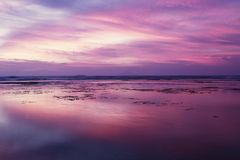 Beautiful sunset with purple sky on beach Royalty Free Stock Photo
