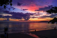 Beautiful sunset with red, purple and yellow colors at the beach in Thailand stock photos