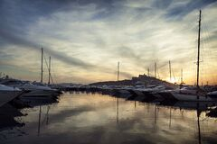 Beautiful sunset with reflected clouds in Ibiza marina port in Balearic Islands of Spain
