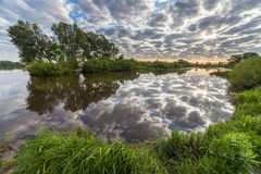 Beautiful sunset reflected on the River. The Beautiful sunset reflected on the River Royalty Free Stock Photos