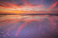 Beautiful sunset and reflections on the beach Royalty Free Stock Image