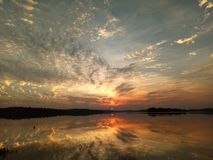 Beautiful sunset with reflexion over the lake, nice landscape for background. Sunset over the lake with reflexion Stock Photography