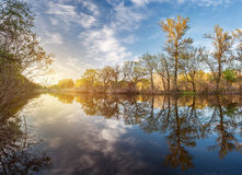 Beautiful sunset on the river in forest with sky reflection. Spring in Ukraine Stock Photo