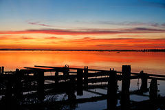 Beautiful sunset on the river parana in Entre Rios, Argentina, south america. Sunset with orange and red tones over blue sky Stock Photography