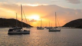 Beautiful sunset and sailboats in Kolona double bay Kythnos island Cyclades Greece. Travel destinations September 2018. Horizontal stock photos