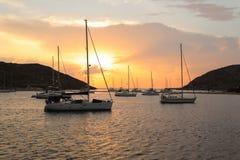 Beautiful sunset and sailboats in Kolona double bay Kythnos island Cyclades Greece. Travel destinations September 2018. Horizontal royalty free stock photos