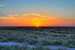 Beautiful sunset on salt lake Chott el Djerid, Sahara desert, Tu Stock Photography