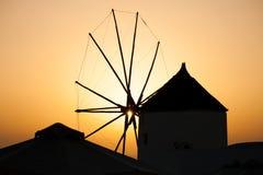 Beautiful sunset on Santorini island, Greece. Beautiful sunset through a windmill on Santorini island, Greece Royalty Free Stock Photo