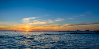 Beautiful sunset on the sea. In the background of a lonely lighthouse Royalty Free Stock Image