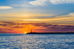 Beautiful sunset on the sea. In the background of a lonely lighthouse Stock Photography
