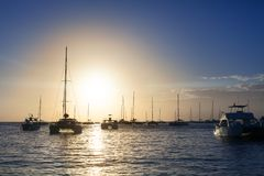 Beautiful sunset on the sea beach, boats, ships and yachts on water background stock photos