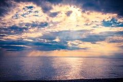 Beautiful sunset on sea Stock Photos