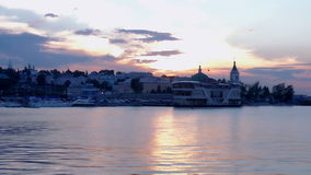 Beautiful sunset on the sea, embankment. City center. Slow motion. HD stock footage
