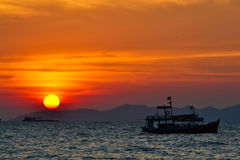 Beautiful Sunset On Sea and fishing boat. Of Thailand Stock Photos