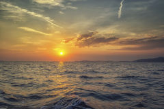 A beautiful sunset on sea. Beautiful game of clouds and sun at sunset Stock Photography