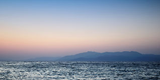 Beautiful sunset on sea and mountain Royalty Free Stock Image