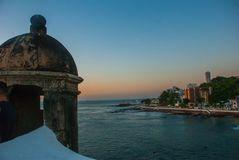 Beautiful sunset on the sea. Panoramic view of Barra Lighthouse in Salvador, Bahia, Brazil. South America royalty free stock images