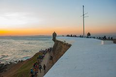 Beautiful sunset on the sea. Panoramic view of Barra Lighthouse in Salvador, Bahia, Brazil. South America royalty free stock photos