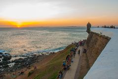 Beautiful sunset on the sea. Panoramic view of Barra Lighthouse in Salvador, Bahia, Brazil. South America stock image