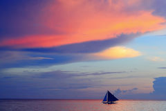 Beautiful sunset with sea and sailboat Royalty Free Stock Photos