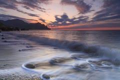 Beautiful sunset on sea shore Royalty Free Stock Photos