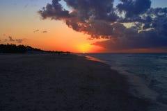 Beautiful sunset on the sea shore Stock Image