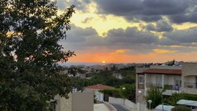Beautiful scenery of evening sun. Beautiful sunset on the sea. View from balcony of building. Wonderful scenery of sunset in tropical country. Small town in stock video