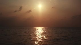 Beautiful sunset in the sea, view from a speed boat. 1920x1080. Hd stock video footage