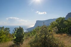 Beautiful sunset and sea views on the southern coast of Crimea. View from the foothills of the mountain Ilyas Kaya. Nature backgro. Beautiful sunset and sea Stock Photo