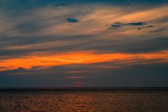 Beautiful sunset seascape over tropical sea. Background for advertisement, cover, calendar, poster. Stock Photo
