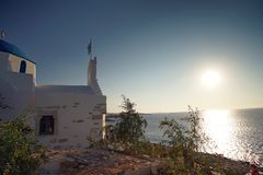 Beautiful sunset seen from the church of Agios Konstantinou, a traditional Cycladic church with blue dome in the town of Paroikia. Paros, Greece european stock images