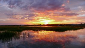 Beautiful Sunset Setting Over Water And Marshlands In The Barrier Island Creekside Waters Of The South Carolina Coast Stock Photos