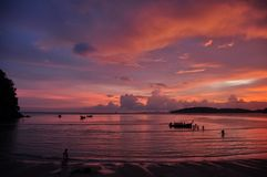 Beautiful sunset on shoreline, Picturesque view of Ao Nang beach with calm waves running on coast against multicolored sunset sky. Thailand royalty free stock photography