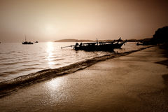 Beautiful Sunset silhouette longtail boat at beach Stock Photography