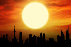 Beautiful sunset with silhouette of skyscrapers Stock Images