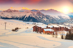 Beautiful sunset and ski resort in the French Alps,Europe. Majestic winter sunrise landscape and ski resort in French Alps,La Toussuire,France,Europe Royalty Free Stock Image