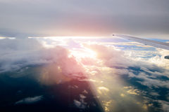 Beautiful sunset sky clouds  seeing through the airplane windows. Royalty Free Stock Images