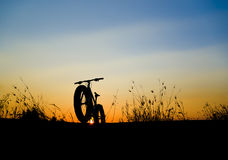 Beautiful sunset sky and Mountain bike silhouette Royalty Free Stock Image