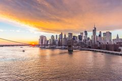 Brooklyn Bridge in a warm sky with sunset stock images