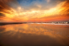 Beautiful sunset sky on the ocean beach Stock Photo