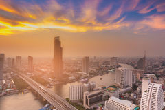 Beautiful sunset sky over Bangkok city river curved aerial view Royalty Free Stock Photo