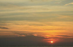 Beautiful sunset with sky over calm sea. Background Stock Photography