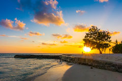 Beautiful sunset with sky over calm sea in tropical Maldives isl. And Royalty Free Stock Images