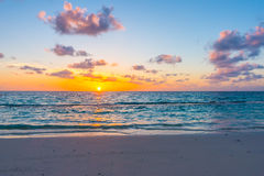 Beautiful sunset with sky over calm sea  in tropical Maldives is Stock Photo