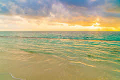 Beautiful sunset with sky over calm sea  in tropical Maldives is. Land Stock Photography