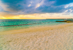 Beautiful sunset with sky over calm sea  in tropical Maldives is. Land Stock Photos